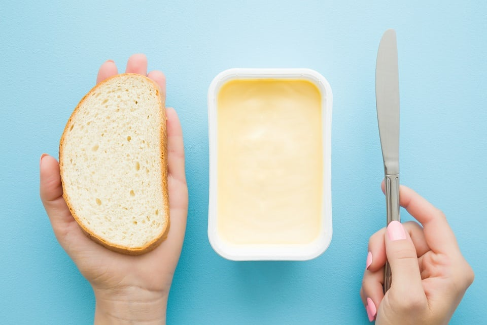 it's not good for a dog to eat margarine. It's just as high in fat as butter