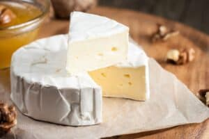 Circle of brie cheese cut into a slice